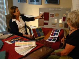 Interior designer working with client.